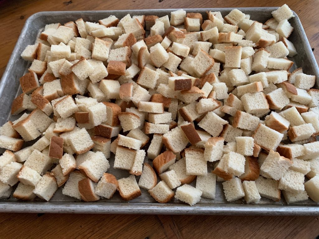 White bread cut into bite sized pieces for stuffing prep.