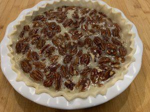pecan pie prepared to go into the oven