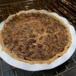 Southern Pecan Pie in the oven baking