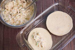 spreading the mixture into the tortillas