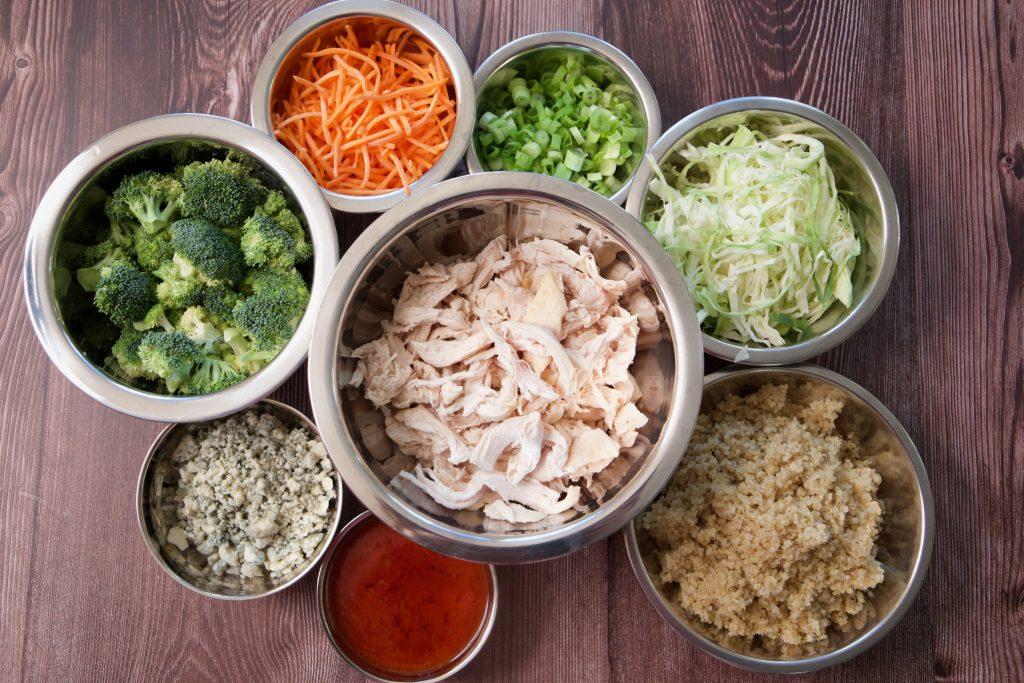 ingredients ready to make buffalo chicken quinoa salad