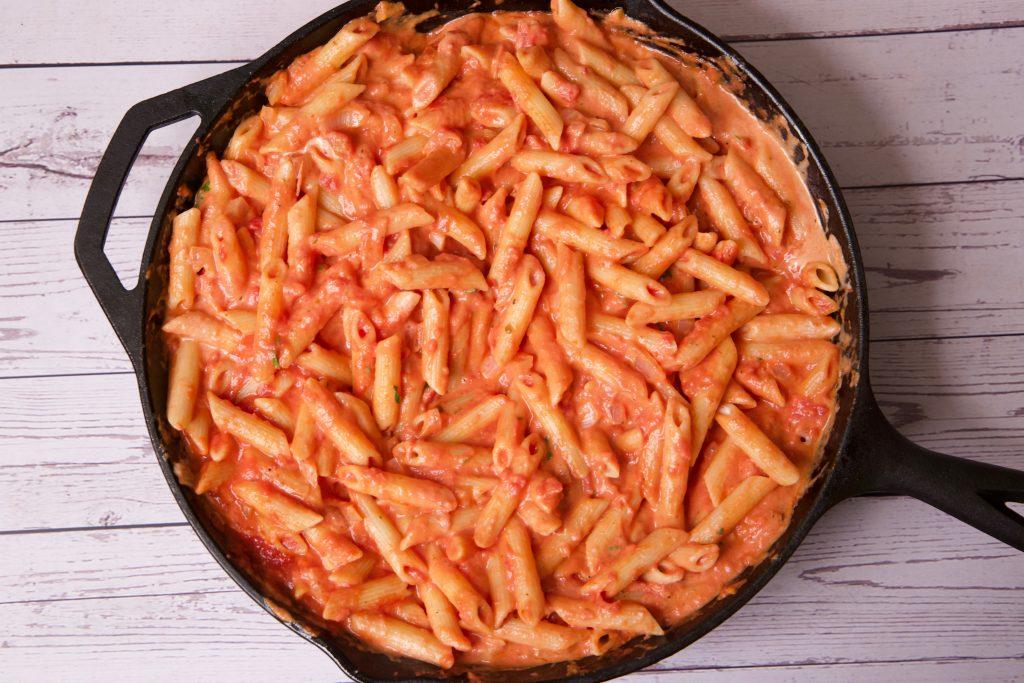 cooking creamy chicken pasta
