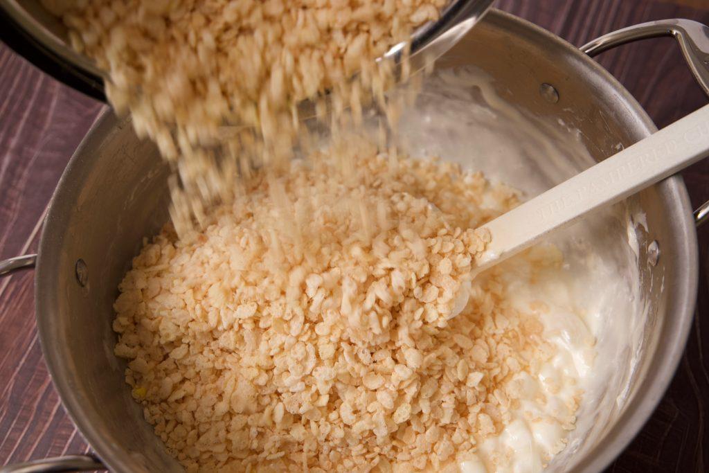 stirring in the Rice Krispies