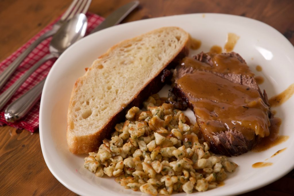 spaetzle and sauerbraten ready to eat