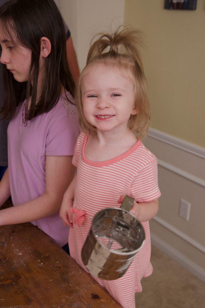 happy helper making kolaches