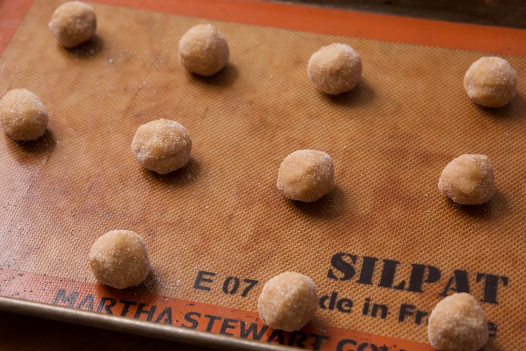dough rolled into balls and sugared